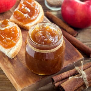 jar of apple butter and toast on board