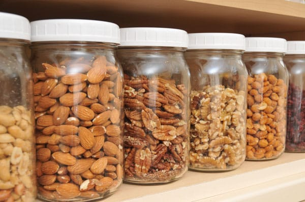 various nuts in glass jars