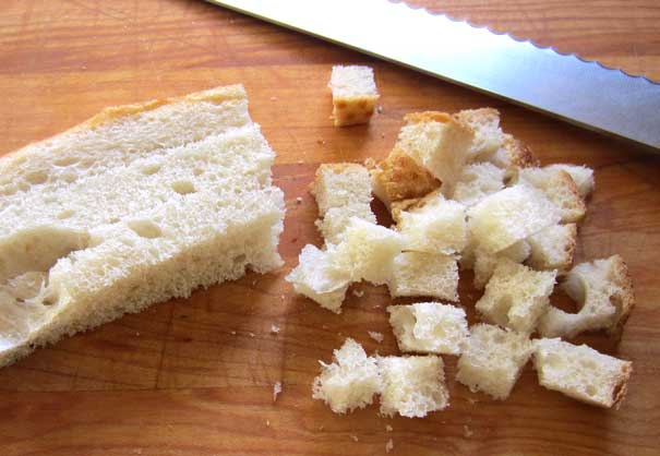 bread being cut into cubes