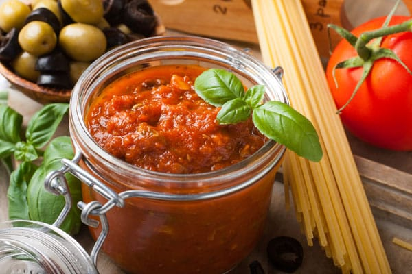 jar of homemade spaghetti sauce with basil