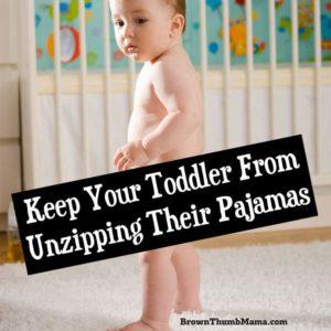 baby who has taken off his pajamas
