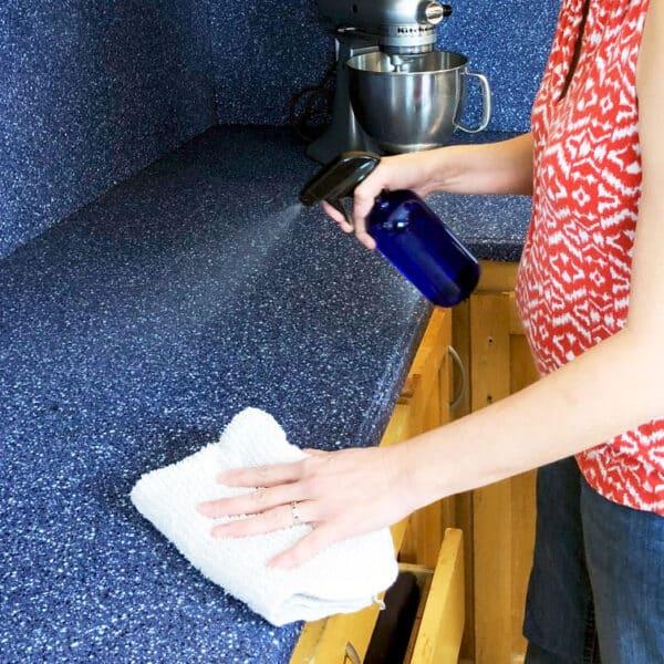woman spraying counter