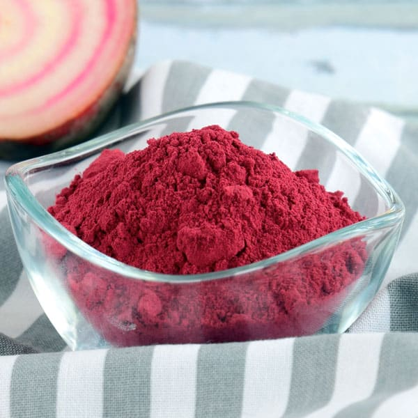beet root powder in glass bowl on table