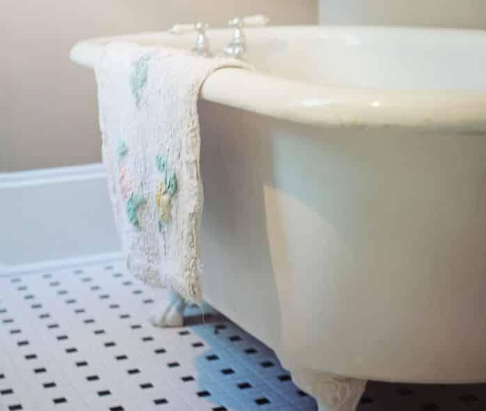 claw foot bathtub and towel