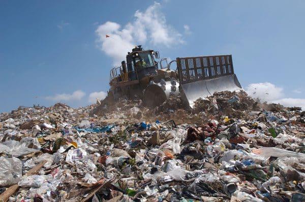 bulldozer on pile of garbage