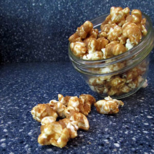 caramel corn spilling from jar