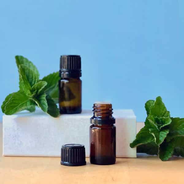 essential oil bottles on white box