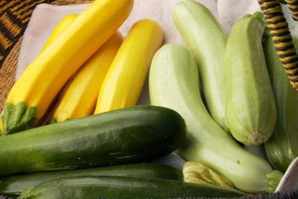 yellow, light green, dark green zucchini in basket