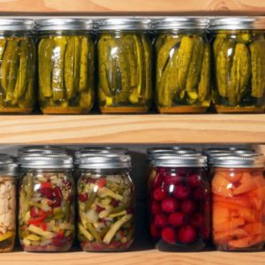 rows of home canned food in jars