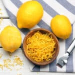 lemons and a bowl of lemon peel on a table