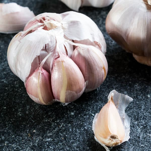 head of garlic on black counter
