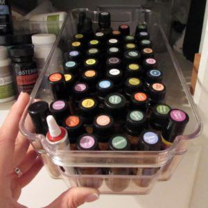 essential oils in an organizer bin