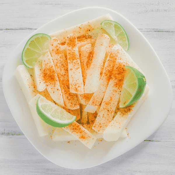 sliced jicama and chile with lime on plate