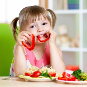 toddler eating red bell peppers
