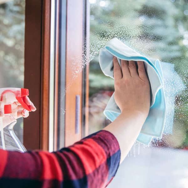 woman cleaning window