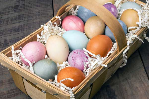 colorful naturally dyed easter eggs in wicker basket