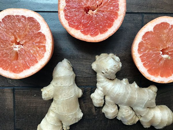 grapefruit and ginger on wood