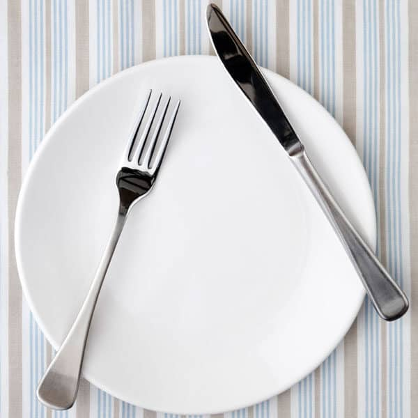 place setting on striped tablecloth