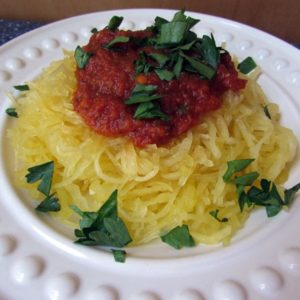 spaghetti sauce on top of cooked spaghetti squash