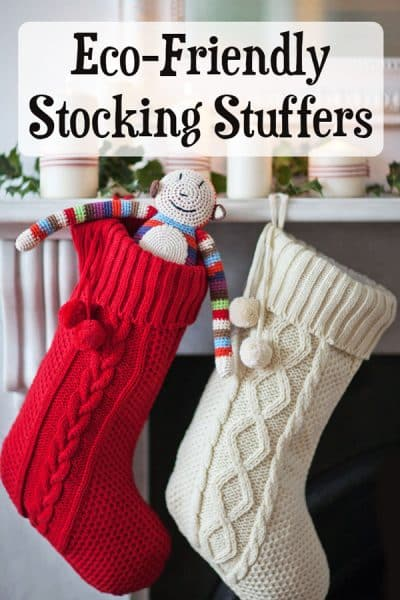 knit stockings hung on mantel with gifts inside