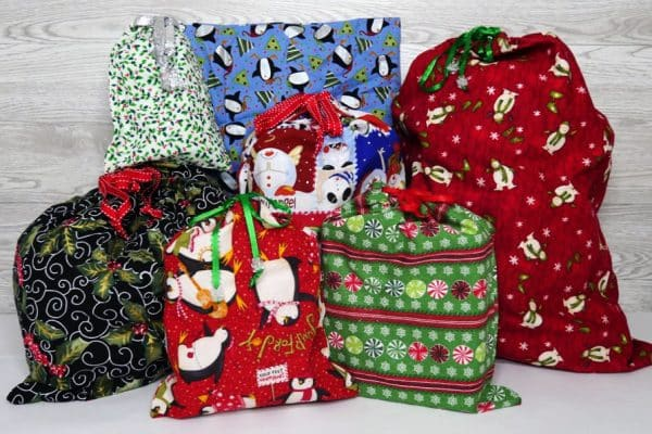 colorful fabric gift bags full of presents