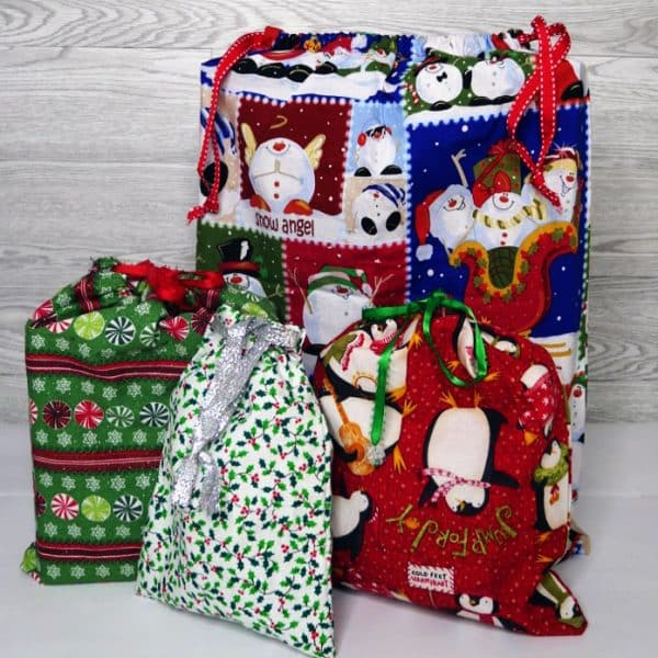 fabric gift bags with Christmas gifts