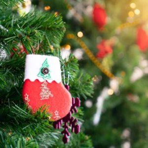 tiny christmas stocking hanging on tree