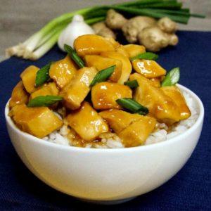 close up of honey garlic chicken over rice