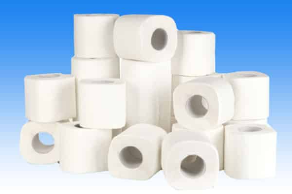 rolls of white toilet paper on blue background