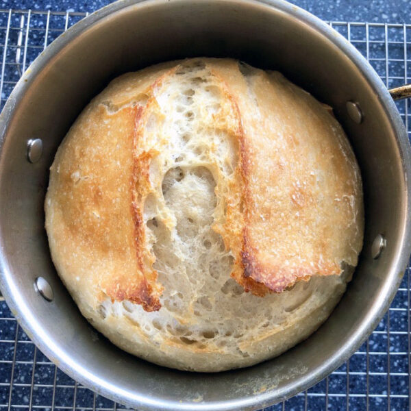 baked homemade bread in round pan