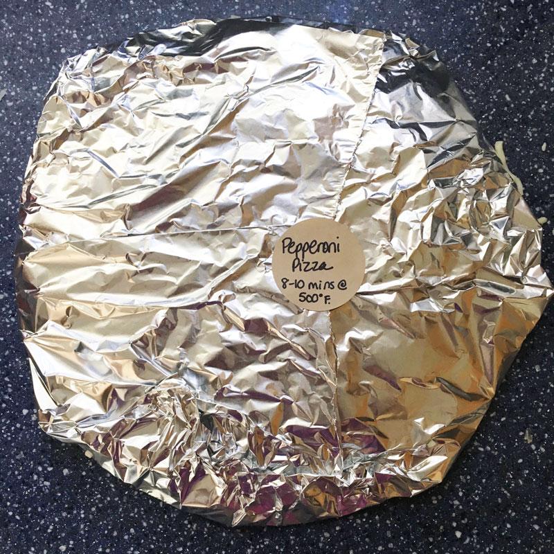 frozen pizza wrapped in foil