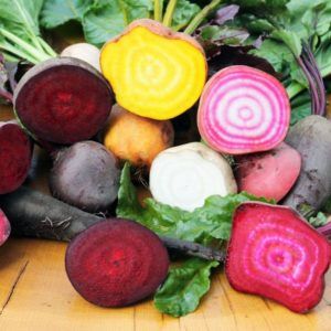 colorful beets on wooden board