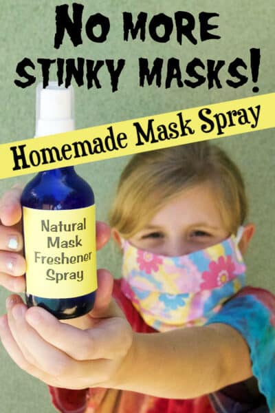 girl wearing mask holding spray bottle