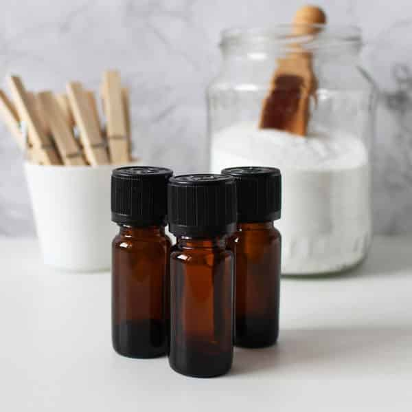 essential oils and baking soda on table