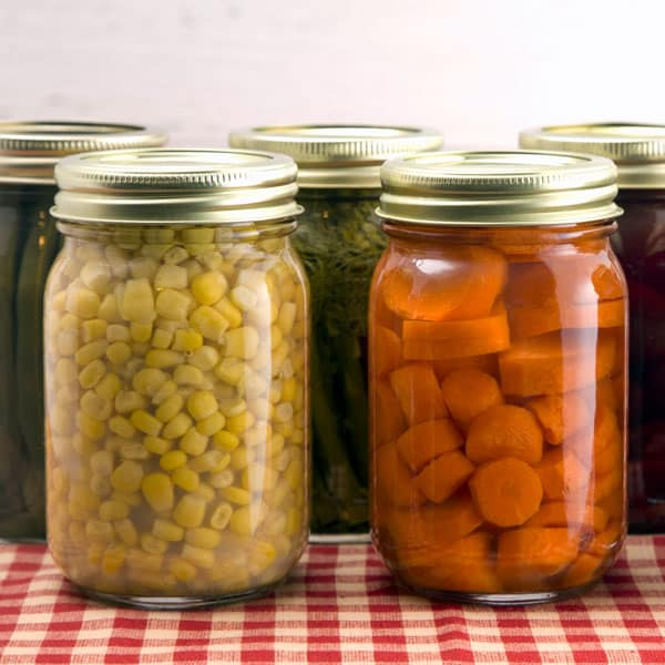 home canned vegetables on gingham cloth