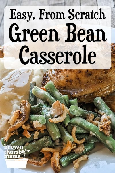 green bean casserole on plate with potatoes and chicken