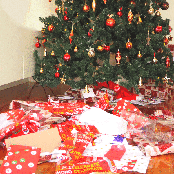 wrapping paper mess under Christmas tree