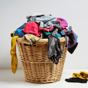 wicker laundry basket full of stained clothes