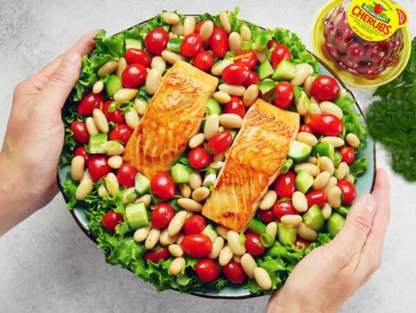 salmon and tomato salad on plate