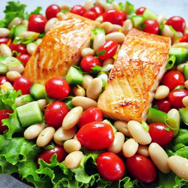 salmon tomato salad on plate