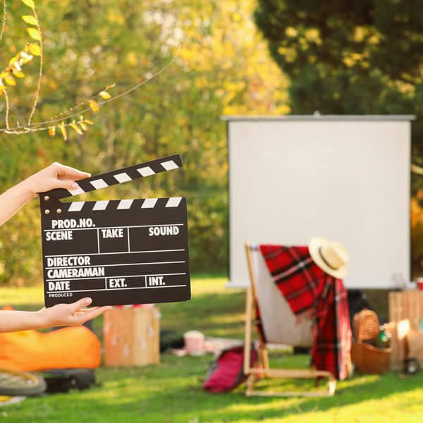 movie clapper and screen in garden
