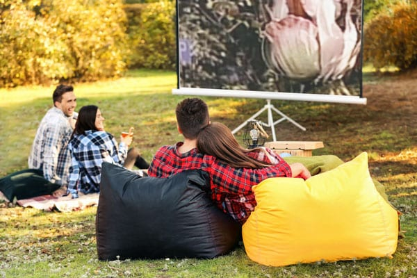 couples watching movie outdoors