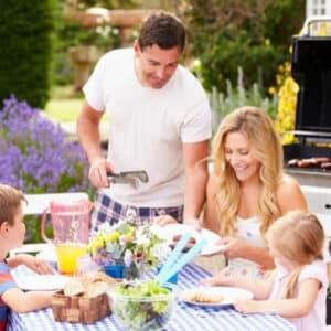 family having lunch outside
