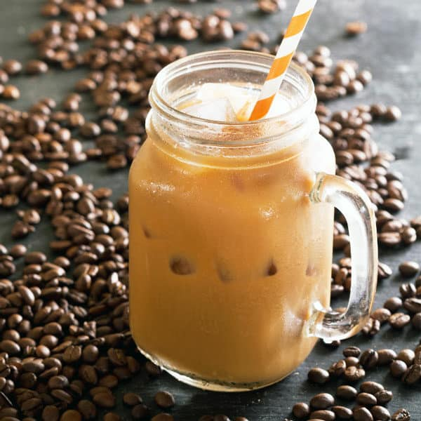 iced coffee in glass with coffee beans